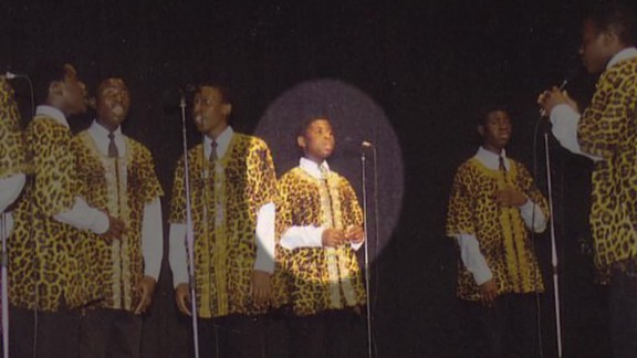 Given Kachepa as a child, performing with the choir.