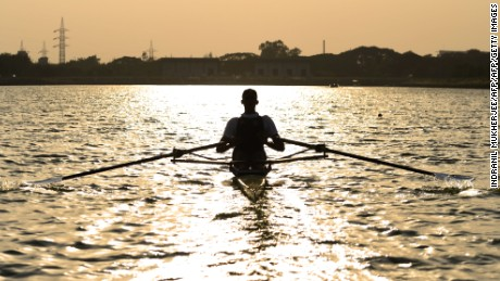 In this photograph taken on May 2, 2016, Indian rower Dattu Bhokanal rows during a training session at the College of Military Engineering in Pune.      Dattu Bhokanal, a rower from a drought-stricken village in dusty western India where residents don't have enough to drink has achieved an improbable feat -- he's qualified for the summer Olympics in Rio.   / AFP / INDRANIL MUKHERJEE / TO GO WITH AFP STORY Oly-2016-IND-rowing-weather-drought,INTERVIEW        (Photo credit should read INDRANIL MUKHERJEE/AFP/Getty Images)