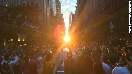 "The ""Manhattanhenge"" sunset was perfectly aligned Monday, giving onlookers a visual treat in New York."