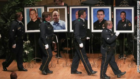 Police officers arrive at an interfaith memorial service, honoring five slain police officers, at the Morton H. Meyerson Symphony Center on July 12, 2016 in Dallas, Texas. A sniper opened fire following a Black Lives Matter march in Dallas killing five police officers and injuring 12 others. (Photo by Tom Pennington/Getty Images)