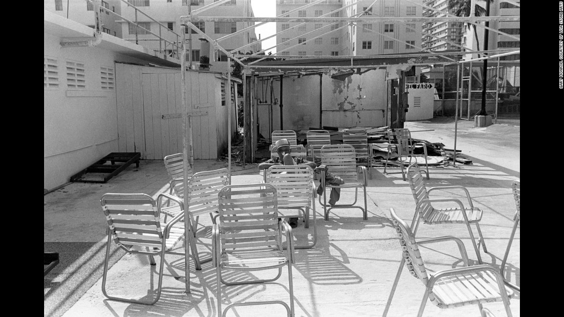 "A man is surrounded by chairs in 1982. Monroe describes the South Beach of now as a place comprised of ""clubbing 'til dawn, drinking from supersized fishbowl glasses and finding a parking space."""