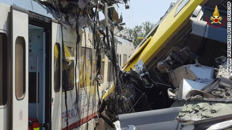 Crumpled wagon cars are seen after the two commuter trains collided.