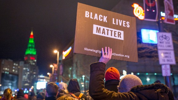 Black Lives Matter demonstrators march in Cleveland on December 29, 2015, after a grand jury declined to indict Cleveland Police officer Timothy Loehmann for the fatal shooting of Tamir Rice on November 22, 2014.