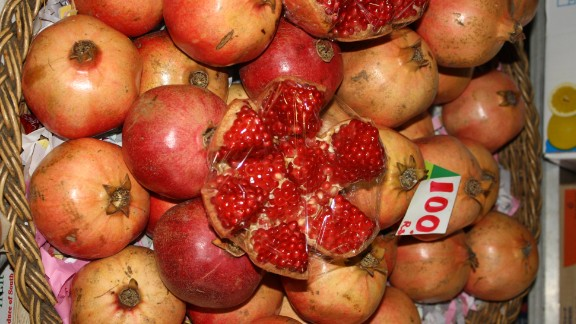 As a country's income goes up, people are in theory able to buy more healthy foods.   Pictured here, pomegranates at a market in Mauritius.