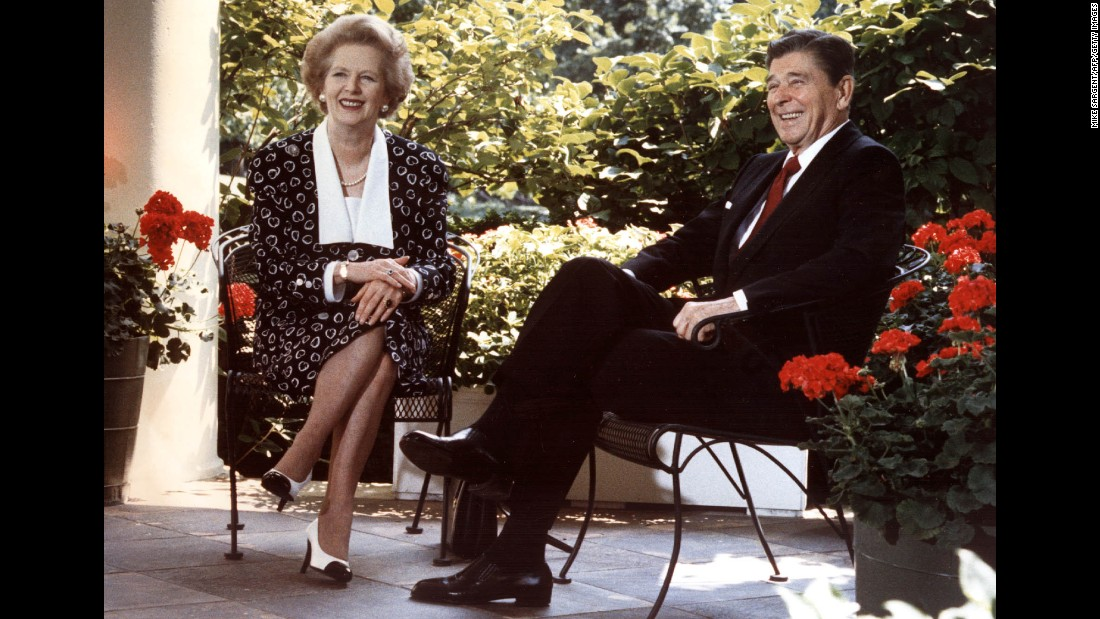 Ronald Reagan and Margaret Thatcher pose for photographs outside of the Oval Office in July of 1987.