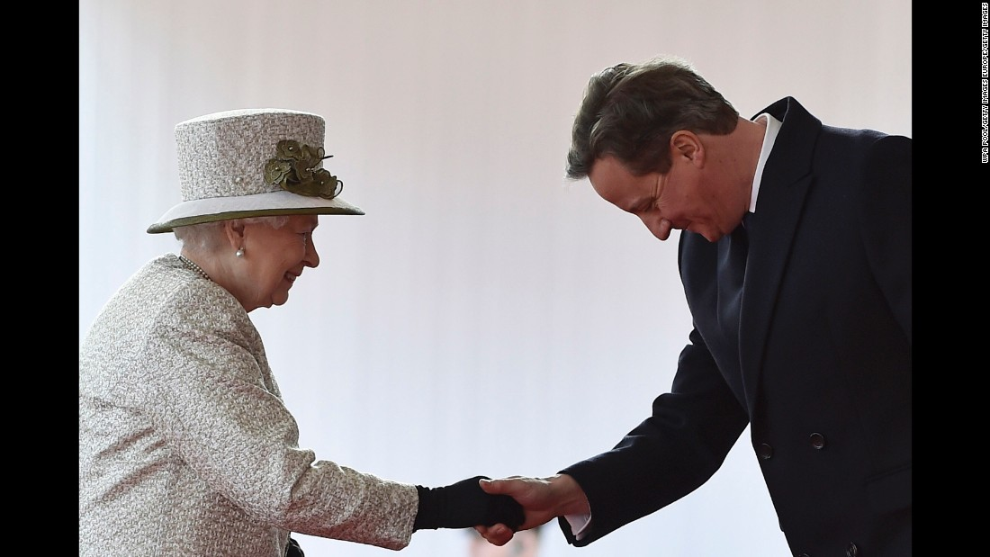 Cameron bows as he greets Queen Elizabeth II during the Mexican President's state visit on March 3, 2015.