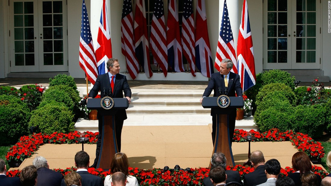 Tony Blair listens as George W. Bush speaks at a news conference in the Rose Garden in May of 2007, on Blair's final visit to Washington before stepping down as prime minister.