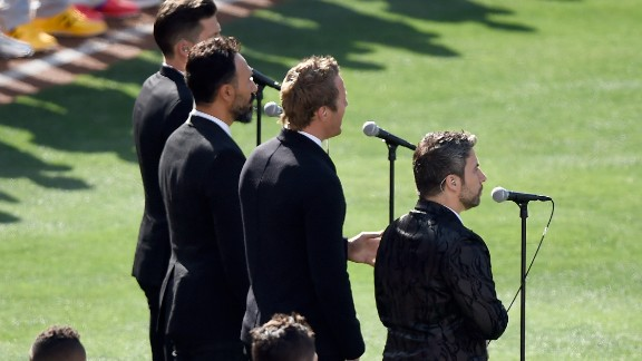 The Tenors perform 'O Canada' prior to the 87th Annual MLB All-Star Game at PETCO Park on July 12, 2016 in San Diego, California. Remigio Pereira is on the far right.