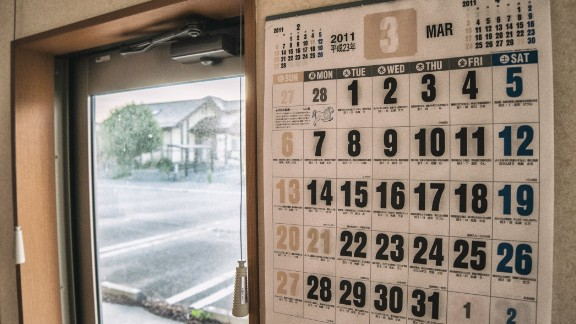 A calendar, stuck in time, shows the date March 3, 2011. More than 20,000 people were reported dead or missing in the aftermath of the earthquake and tsunami, while hundreds of thousands more lost their homes.