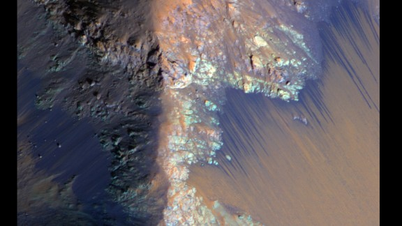 Recurring slope lineae (RSL) on Mars are seasonally abundant along the steep slopes of ancient bedrock in the Valles Marineris canyon region. Here, the RSL are depicted as bright fans that extend down the slopes.