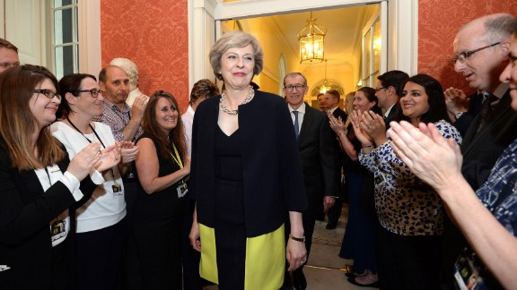 Staff members clap as new Prime Minister Theresa May walks into 10 Downing Street.