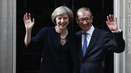 British Prime Minister Theresa May and husband Philip May wave outside 10 Downing Street on July 13, 2016 in London, England.