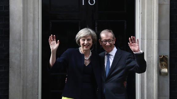LONDON, ENGLAND - JULY 13:  British Prime Minister Theresa May and husband Philip May wave outside 10 Downing Street on July 13, 2016 in London, England. Former Home Secretary Theresa May becomes the UK