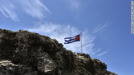 A Cuban flag flutters on top of a rock near the U.S. Embassy in Havana on August 13, 2015.