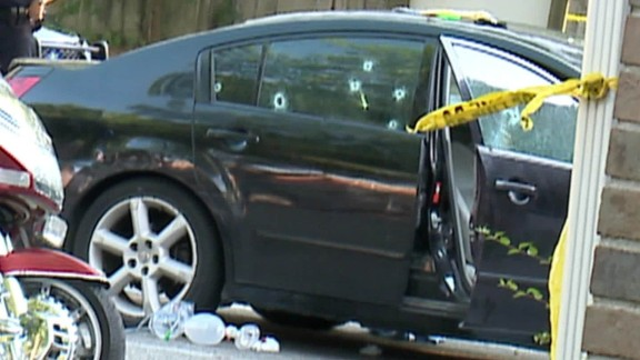 Their car was riddled with bullet holes.