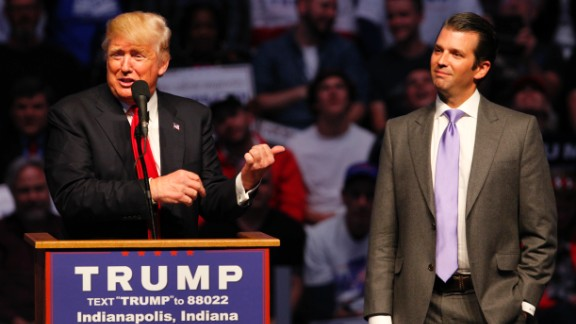 Presumptive Republican nominee Donald Trump introduces his son Donald Trump Jr. as he addressed a crowd this April in Indianapolis. Trump Jr. has said that if his father becomes president, he