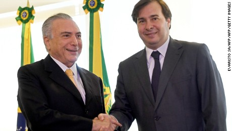 Brazilian acting President Michel Temer (L) and the new president of Lower House of teh Brazilian Congresss, Rodrigo Maia, shake hands during a meeting at Planalto Palace in Brasilia, on July 14, 2016.  Maia was elected to replace Eduardo Cunha who resigned due to allegations of corruption. / AFP / EVARISTO SA        (Photo credit should read EVARISTO SA/AFP/Getty Images)