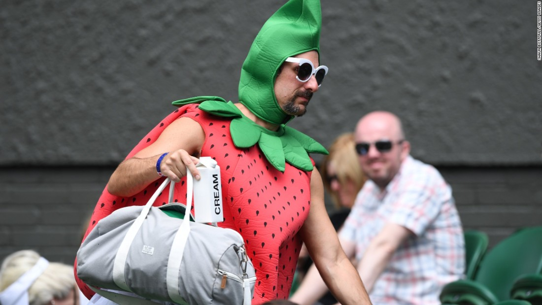 Chris Fava,40, traveled 5,000 miles from California to attend the tournament, dressed as a giant strawberry complete with carton of cream.