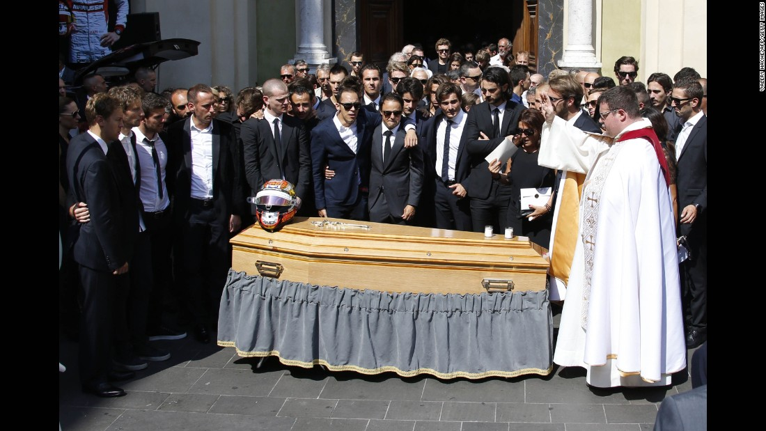Family and friends of Bianchi, including fellow F1 drivers, stand by his coffin after his funeral at the Cathedrale Sainte Reparate in Nice on July 21, 2015 in southeastern France. Bianchi died in a hospital in his hometown of Nice from head injuries he sustained in the October 5, 2014 crash.
