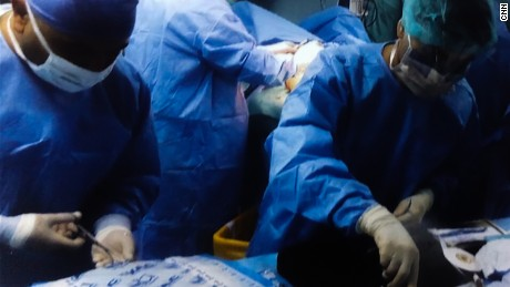 Surgeons -- who cannot be named to protect their identity -- perform surgery.