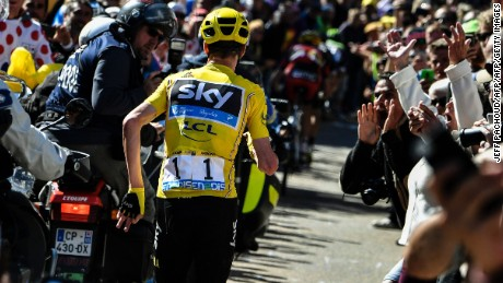 Great Britain's Christopher Froome (C), wearing the overall leader's yellow jersey, runs to get a replacement bike following a fall during the 178 km twelvelth stage of the 103rd edition of the Tour de France cycling race on July 14, 2016 between Montpellier and Chalet-Reynard. / AFP / JEFF PACHOUD        (Photo credit should read JEFF PACHOUD/AFP/Getty Images)