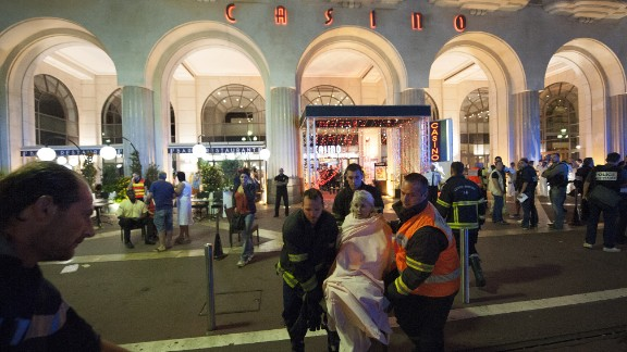 Wounded victims of the attack in Nice, France, are evacuated from the scene.