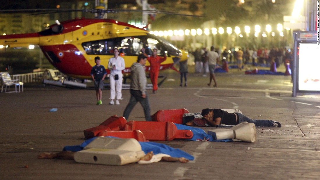 A man lies near a covered body at the scene of the attack on the Promenade des Anglais in Nice.
