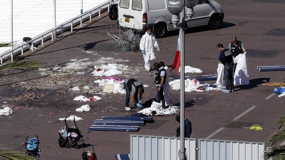 A forensics team inspects the scene of the attack.