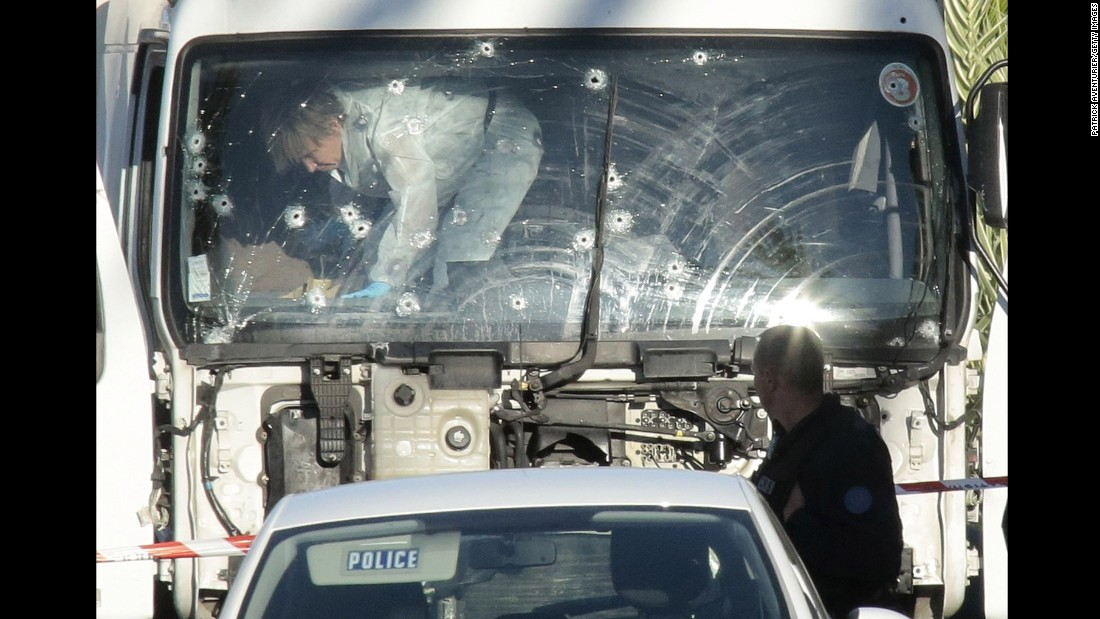 Forensics investigators examine a truck at the scene of the attack.