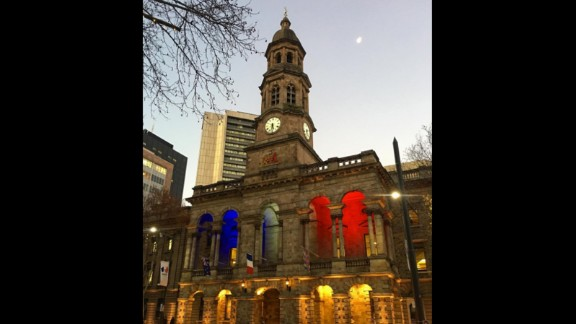 The town hall in Adelaide, Australia, is lit up in the colors of the French flag.
