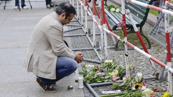 A man near the French Embassy at Paris square in Berlin pays tribute to the victims of the Nice attack.