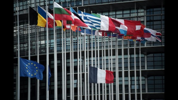 The French and European Union flags fly at half-staff in front of the European Parliament building in Strasbourg, France.
