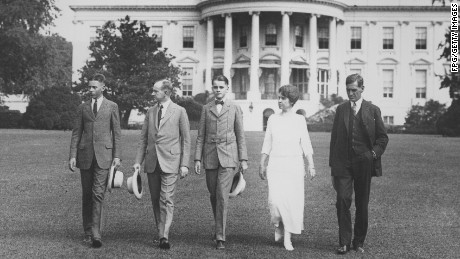 (From left to right) John Coolidge, United States President Calvin Coolidge, Calvin Coolidge, Jr., first lady Grace Coolidge and George Christian looking over the White House lawns, Washington, D.C., in 1930.