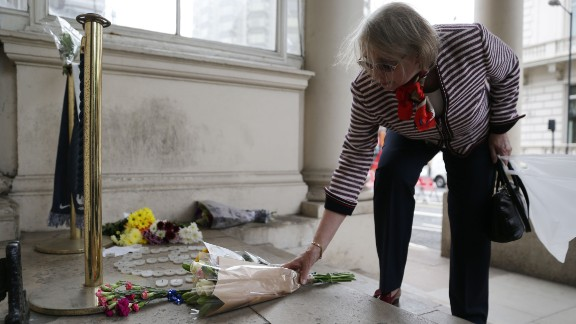 A woman places flowers outside the French Embassy in London.