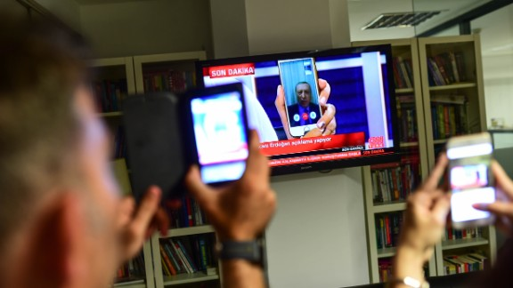 President Recep Tayyip Erdogan speaks on CNN Turk via a FaceTime call in Istanbul after members of the country