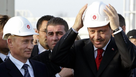 Russian President Vladimir Putin, left, and Erdogan wear helmets in Durusu village near Turkey