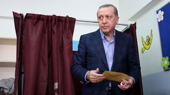 Erdogan leaves a polling booth after casting his vote in Turkey