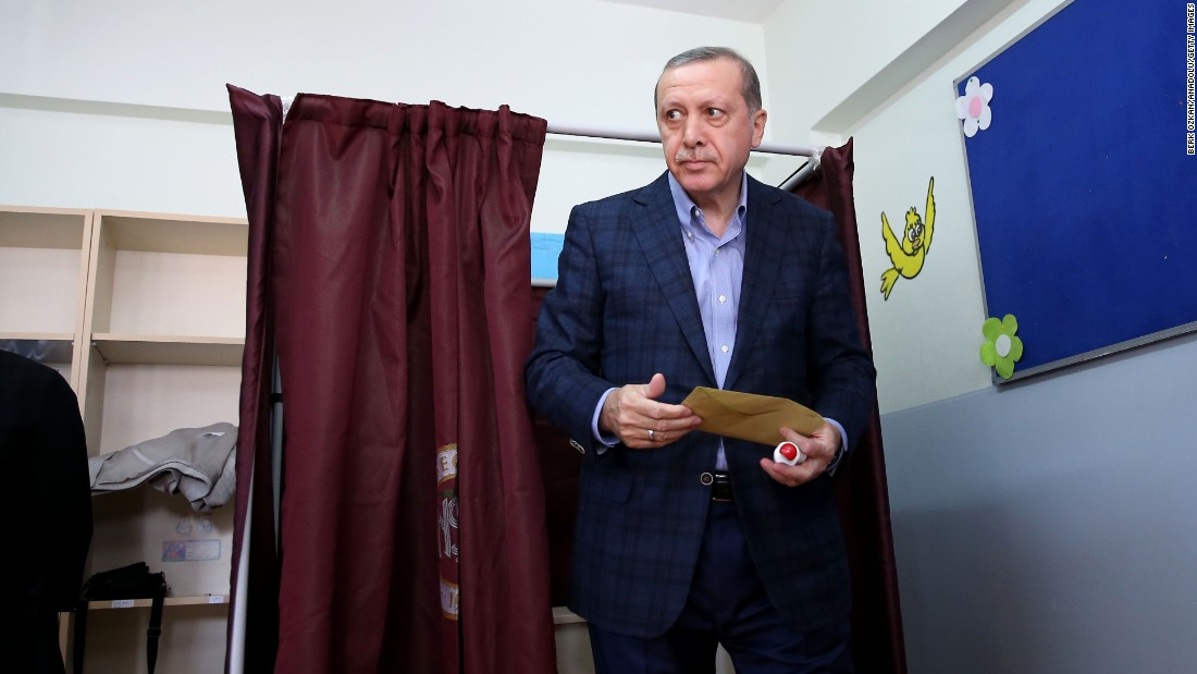 Erdogan leaves a polling booth after casting his vote in Turkey's 26th general election at a polling station in Istanbul on November 1, 2015.
