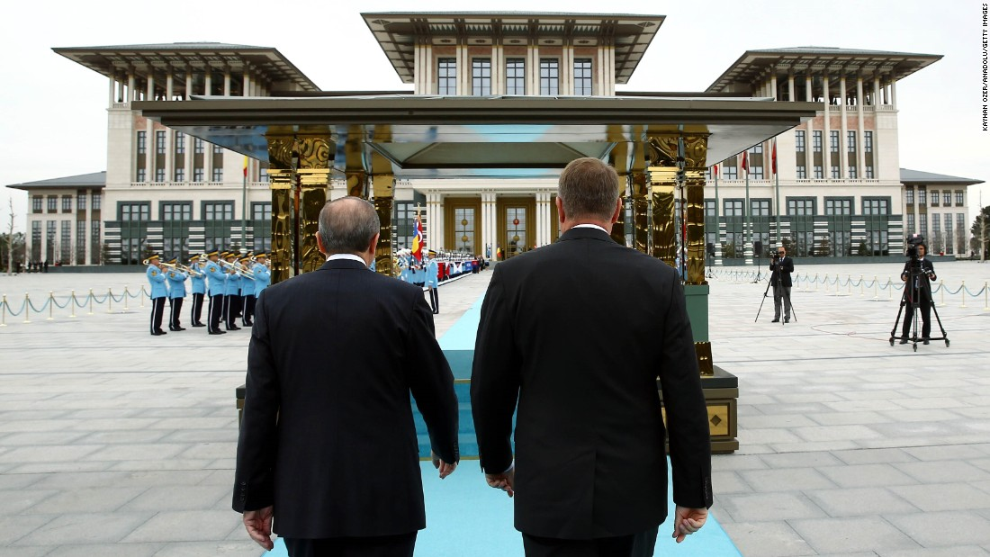 Romanian President Klaus Werner Iohannis, right, and Erdogan walk together during an official welcoming ceremony at the presidential complex in Ankara, Turkey, on Wednesday, March 23.