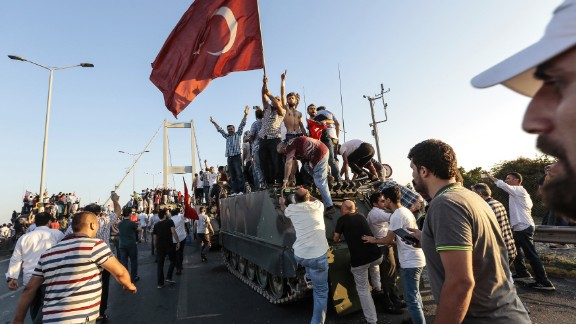 Erdogan supporters capture a Turkish army vehicle after soldiers surrendered Saturday.