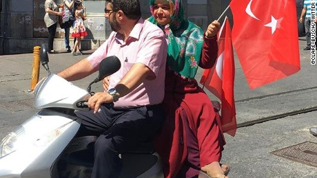 A scooter joins demonstratord headed toward Taksim Square.