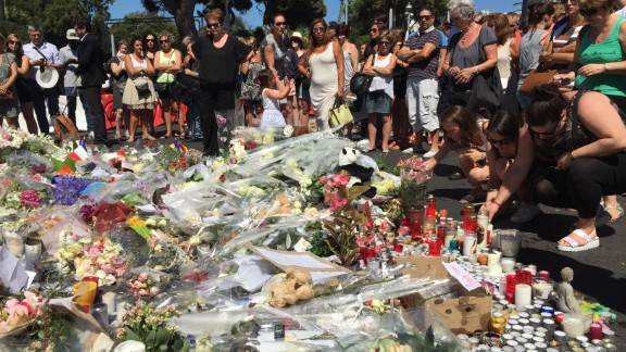 People left flowers, candles and other tributes in Nice, France, on Saturday in memory of those killed in Thursday