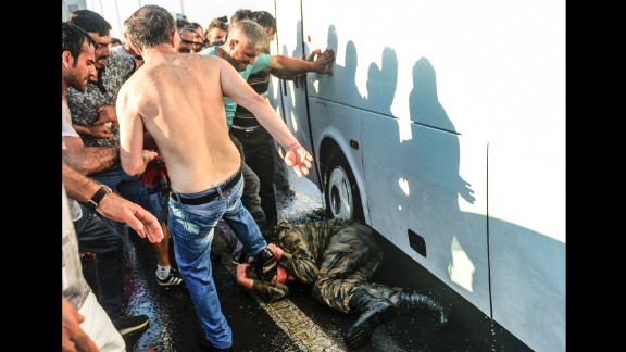 People kick and beat a Turkish soldier suspected in the attempted coup on Istanbul