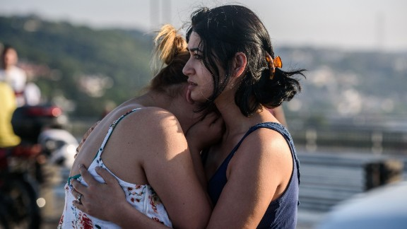Women react after people took over a military position on the Bosphorus Bridge in Istanbul.