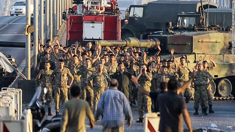 ISTANBUL, TURKEY - JULY 16: Soldiers involved in the coup attempt surrender on Bosphorus bridge with their hands raised on July 16, 2016  in Istanbul, Turkey. Istanbul's bridges across the Bosphorus, the strait separating the European and Asian sides of the city, have been closed to traffic. Turkish President Recep Tayyip Erdogan has denounced an army coup attempt, that has left atleast 90 dead 1154 injured in overnight clashes in Istanbul and Ankara. (Photo by Gokhan Tan/Getty Images)