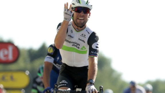 Mark Cavendish holds up four fingers after taking the 14th stage of the Tour de France for Team Dimension Data -- his fourth in this year's race.