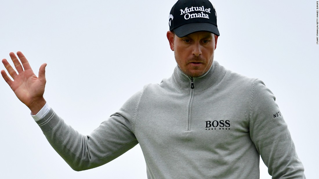 Henrik Stenson of Sweden celebrates his birdie on the 17th at Royal Troon on his way to claiming the third round lead at the British Open.