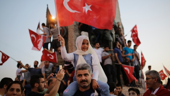 People wave flags in Istanbul