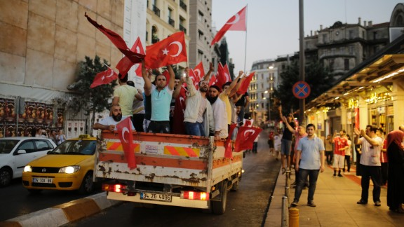 People flood Taksim Square following the President