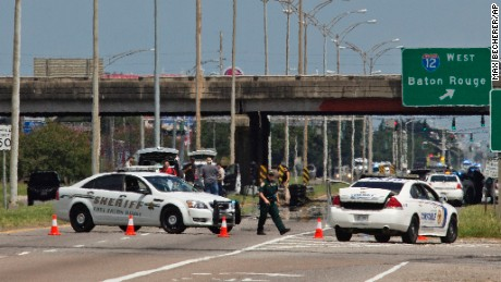 Baton Rouge police block Airline Highway after police were shot in Baton Rouge, Louisiana on Sunday July 17.